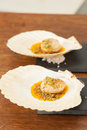 Scallop unfinished seared with parmesan crust and egg yuzu sauce Stock Photos