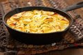 Scalloped potatoes in a rustic iron skillet Stock Photos