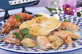Scallops baked with mixed shellfish Stock Photography