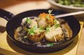 Scallops in sake butter sauce delicious made with Royalty Free Stock Image