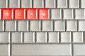 Scam word spelled on a metallic keyboard isolated Stock Photo
