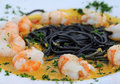 Scampi with pasta and curry Royalty Free Stock Images