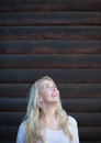 Scandinavian blonde woman posing on wood background young Royalty Free Stock Photos