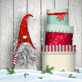 Scandinavian christmas traditional gnome, Tomte, with stack of colorful gift boxes, illustration