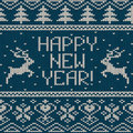 Scandinavian knitted seamless pattern with deers and text happy new year Royalty Free Stock Image