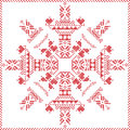 Scandinavian Nordic winter stitch, knitting  Christmas pattern in  in  snowflake shape , with cross stitch frame including , snow Royalty Free Stock Photo