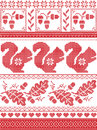 Scandinavian and Norwegian Christmas culture inspired festive winter pattern in cross stitch with squirrel, acorn, oak leaf, heart