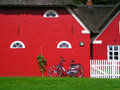 Scandinavian red houses countryside scene and a classic bike Stock Photo