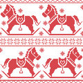 Scandinavian seamless Nordic Christmas pattern with rocking horses, snowflakes,hearts, snow, stars, decorative ornaments in red c