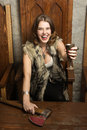 Scandinavian woman in a medieval castle interior sexy with cup of wine Royalty Free Stock Photos