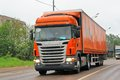 Scania g tver region russia may orange semi trailer truck at the interurban road Stock Image