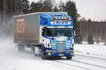 Scania 164L Semi Truck Transports Goods on Snowy Road