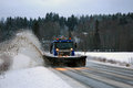 Scania Snowplow Truck Removes Snow off Road Royalty Free Stock Photo