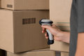 Scanning barcode on box Royalty Free Stock Photo
