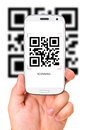 Scanning qr code male hand is holding a modern touch screen phone and Stock Photo