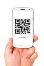 Scanning qr code male hand is holding a modern touch screen phone and Royalty Free Stock Image
