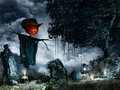 Scarecow among tombstones Royalty Free Stock Photo
