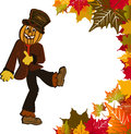 Scarecrow and fall leaves Royalty Free Stock Photo