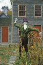 Scarecrow in front of house in New England Historic Village of Waterloo, NJ Royalty Free Stock Photo