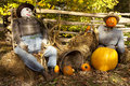 Scarecrow and pumpkin display during fall harvest Stock Photo