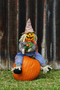 Scarecrow sitting on the pumpkin Stock Photo