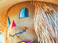 Scarecrow smiling a close up of a s head with straw for hair and a burlap face Royalty Free Stock Photography