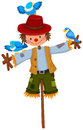 Scarecrow on stick with blue birds Royalty Free Stock Photo