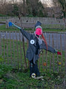 Scarecrow in urban vegetable garden Royalty Free Stock Photo
