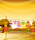 Scarecrows near the hanging clothes illustraton of Royalty Free Stock Image