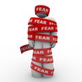 Scared afraid man wrapped in red fear tape a is reading representing the paralysis of being and unable to move or act the face of Stock Images