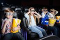 Scared children watching d movie in cinema girl screaming while with siblings theater Royalty Free Stock Photography
