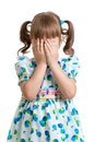 Scared or crying or playing bo-peep kid hiding face Royalty Free Stock Image