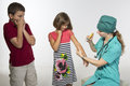 Scared of the doctor two kids are injections Royalty Free Stock Image