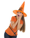 Scared girl in Halloween hat looking on copy space Stock Image