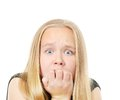 Scared girl pretty making funny face isolated on while Royalty Free Stock Image