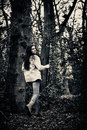 Scared girl running teenage away from camera in woods Stock Photos