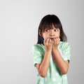 Scared little girl hiding face on grey background with clipping path Stock Photo