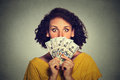Scared looking woman picking through dollar banknotes Royalty Free Stock Photo