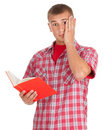 Scared male student with book Royalty Free Stock Photos