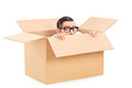Scared man hiding in a carton box isolated on white background Stock Photography