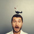 Scared man with small crazy man on the head portrait of Stock Images