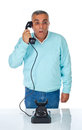 Scared man while talking with bakelite telephone old on white Stock Photography