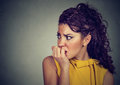 Scared nervous woman biting her fingernails anxious Royalty Free Stock Photo