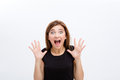 Scared screaming young female in black top over white background Stock Photos