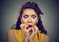 Scared shocked woman isolated on gray background Royalty Free Stock Photo