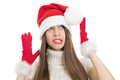 Scared and surprised teenage girl wearing santa costume looking up beautiful caucasian making weird facial expression holding Royalty Free Stock Images