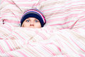 Scared woman hiding in duvet Stock Photos
