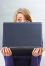 Scared Woman Holding Laptop An...