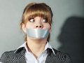 Scared woman with mouth taped shut censorship afraid young girl duct tape on lips and freedom of speech concept Stock Photo