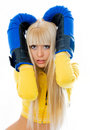 Scared woman wearing boxing gloves Stock Photography